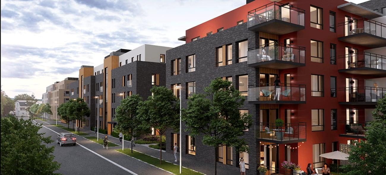 Kveldsbilde av boligblokker i Kvarteret med vei