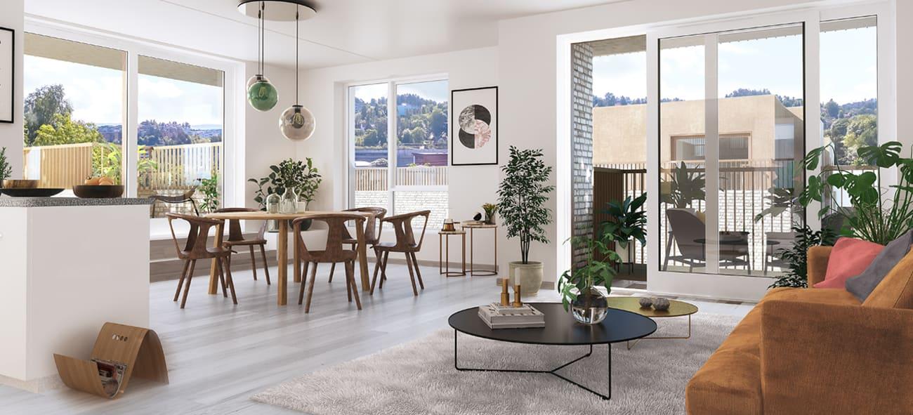 Bilde av stue med salong og spisebord og utgang mot terrasse