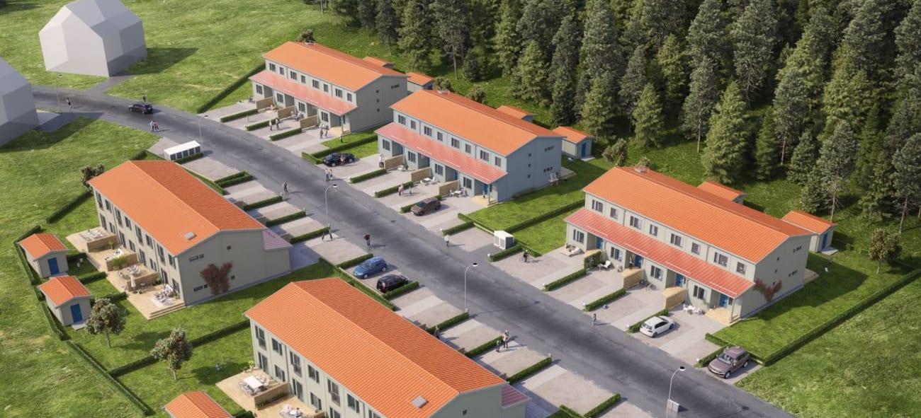 Vi över en boistadsrättsförening med 5 vita hus med orangea tak.