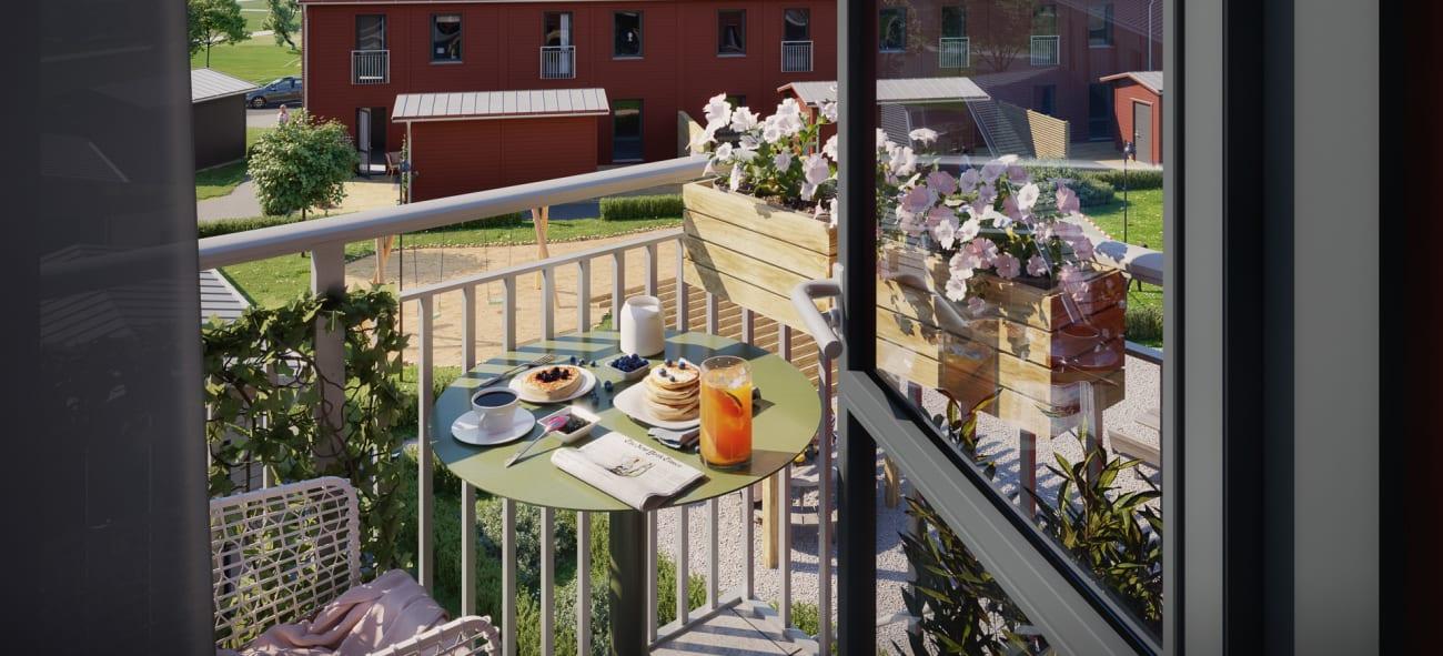 Utsikt på gården mellan bostäderna i Brf Kolonilotten i CV staden Örebro