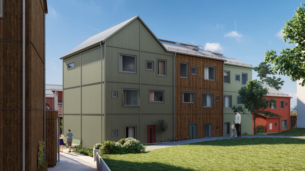 grönt lägenhetshus med stor gräsmatta