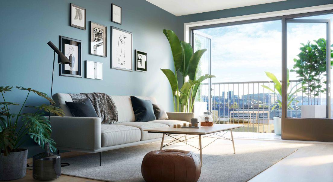 Illustrasjon av stue med sofa og puff med utgang til balkong på Ulvenparken