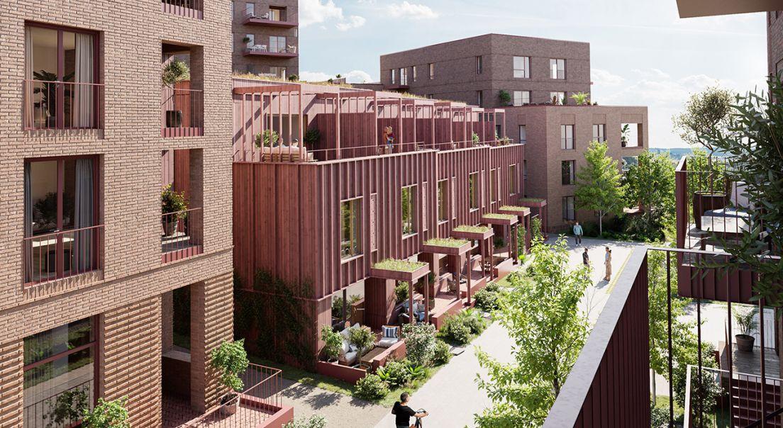 Illustrasjon av fasaden og gårdsrommet til boligprosjektet Nansenløkka, sett fra balkong på dagtid.