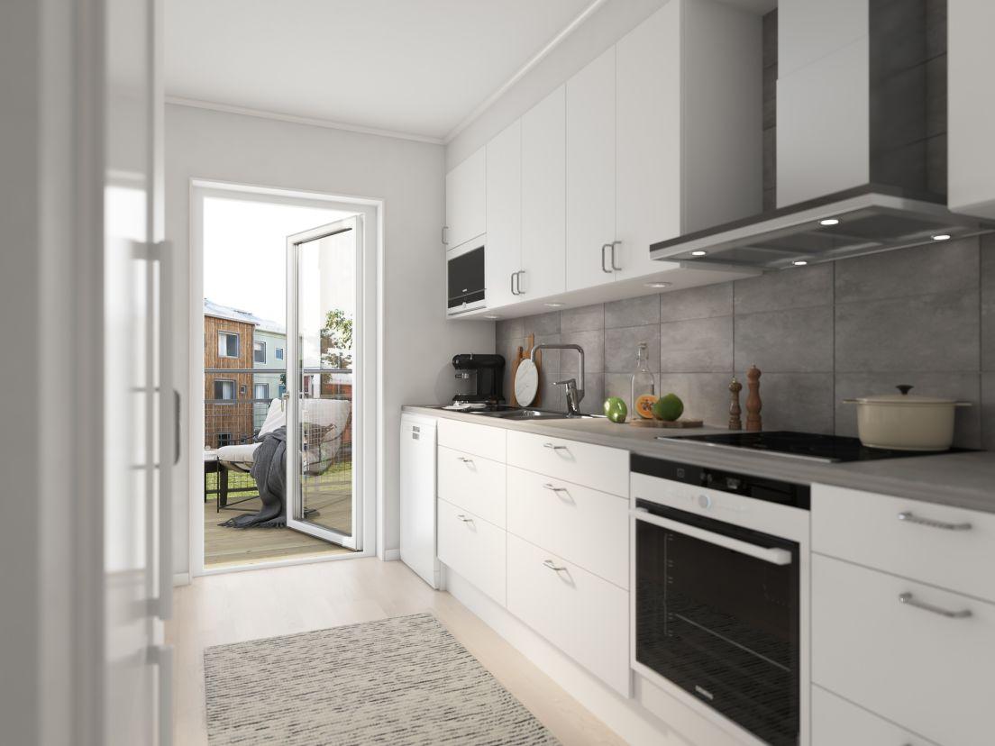 kök med grå väggpanel där köket leder ut mot balkong
