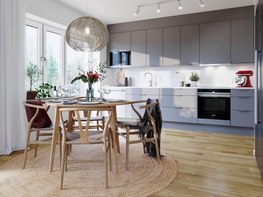 ett dukat matbord i ett kök