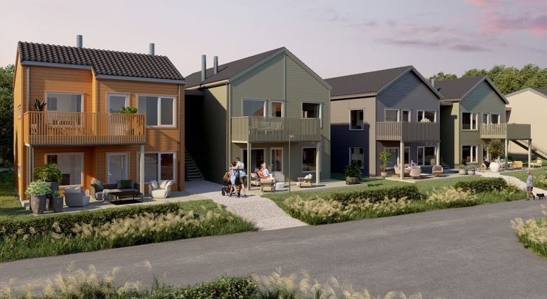 gule, grønne og grå rekkehus med hage