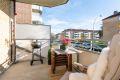 Koselig sydvendt balkong med god plass til utemøblement og grill