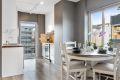 Kjøkken og spiseplass med utgang balkong