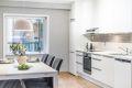 Lekkert kjøkken med glatte fronter og underlimt oppvaskkum