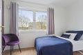 Soverom 2 er litt mindre, men har god plass til seng og nattbord.