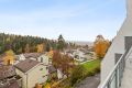 Fritt og luftig utsyn mot by, Østmarka og småhusbebyggelse