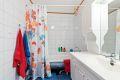 Flislagt bad med opplegg vaskemaskin