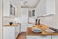 Pent og velholdt kjøkken med integrerte hvitevarer