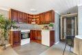 Kjøkken i underetasje. Eldre kjøkkeninnredning med profilerte trefronter. Ventilator.