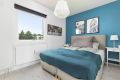 Soverom 2, holdt i stemningsfull stil, god plas for dobbelseng med tilhørende nattbord.