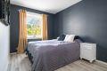 Soverommet er meget romslig, og har godt med plass til dobbeltseng med nattbord på hver side.