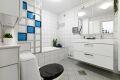 Flislagt bad med varmekabler og badekar