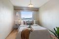 Leilighetens soverom er av god størrelse med plass til dobbeltseng, nattbord og garderobeskap.