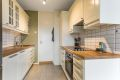 Pent kjøkken med velholdt innredning