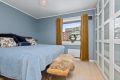 Soverom 1: Stort og lyst soverom med plass til dobbeltseng, nattbord på hver side og stort og praktisk garderobeskap.