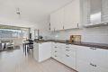 Kjøkken med åpen løsning mot stue.