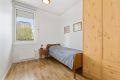 Soverom 2 med plassbygd garderobeskap. Rommet passer perfekt som barnerom, gjesterom eller kontor. Begge soverom ligger skjermet og rolig til.