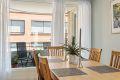 Kjøkkenet har god plass til spisebord og har utgang til balkong