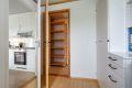 Inngang til innvendig bod fra det minste soverommet. Perfekt som walk in closet.