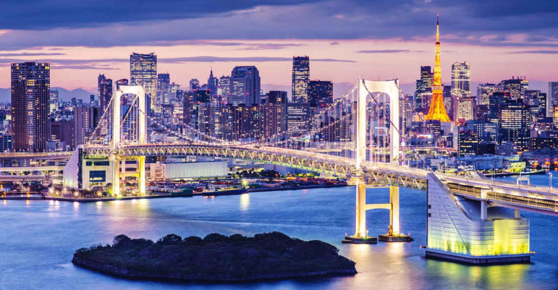 Cityscape with suspension bridge