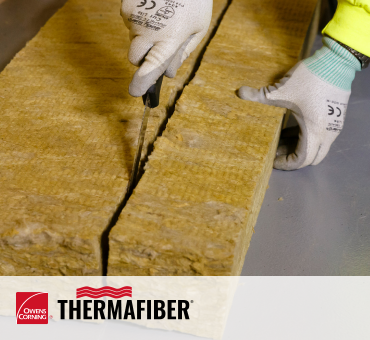 worker cutting mineral wool insulation