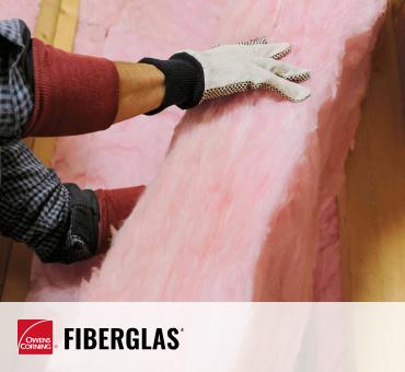 worker installing fiberglass insulation
