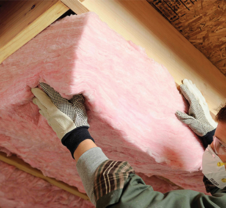 batt of insulation being installed under floor