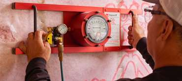 Worker testing insulation