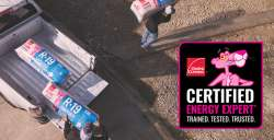 Certified Energy Expert unloading Owens Corning R-19 insulation