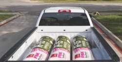 Owens Corning R-15 insulation in the back of white truck