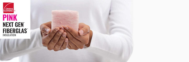hands holding a small piece of next gen fiberglas