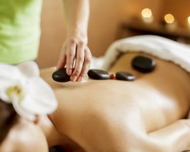 Massagem de Pedras Quentes a 2 | Centro Terapêutico da Dor