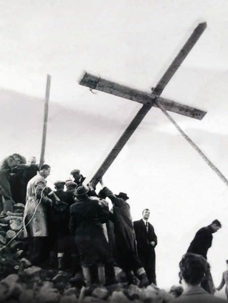 One of the first crossed being erected on Brandon Hill