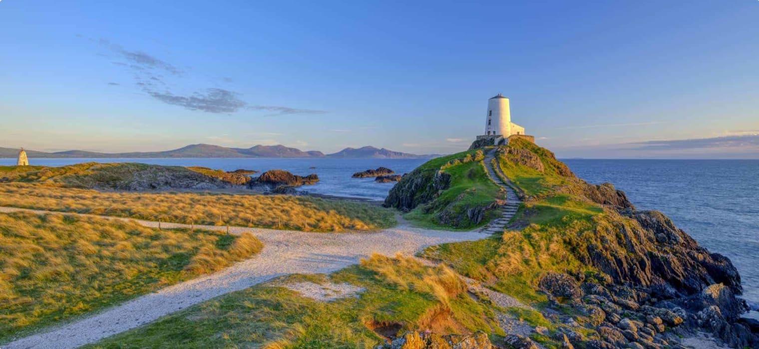 Twr Mar Lighthouse on Llanddwyn Island off Anglesey, Wales UK