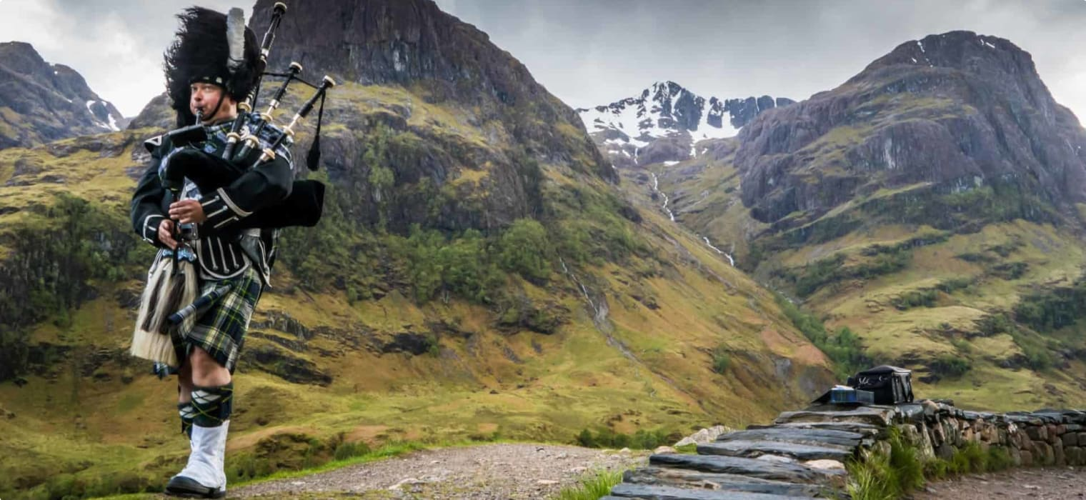 Bagpipe player in the Highlands, Scotland