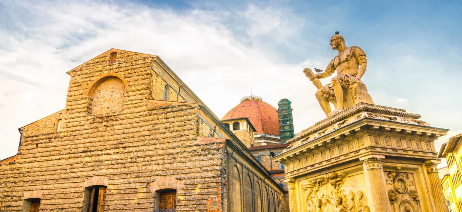 Basilica di San Lorenzo Cappelle Medicee chapel and Giovanni delle Bande Nere monument on Piazza di San Lorenzo square in historical centre of Florence city, blue sky white clouds, Tuscany, Italy