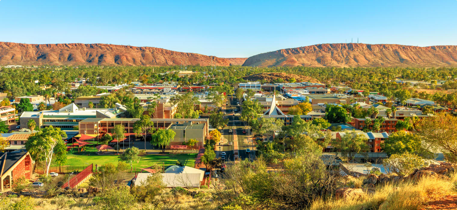 Aerial view of Alice Springs skyline in Australia from Anzac Hill Memorial lookout with main buildings of Alice Springs city downtown. Red Centre desert with Macdonnell ranges