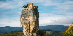 Katskhi pillar. Georgian landmarks. Man's monastery near the village of Katskhi. The orthodox church and the abbot cell on a rocky cliff. Imereti, Georgia. Georgian Meteora