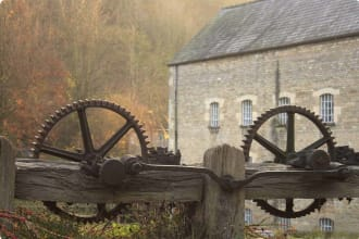 cog wheels, in front of an old Georgian wool mill.