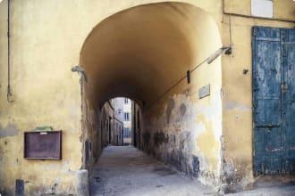 archway in Cortona, Tuscany Italy