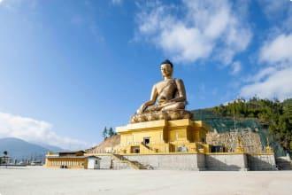 A giant Buddha statue under blue sky in Thimphu, Bhutan