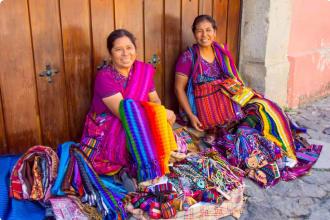 Women selling textiles and souvenirs Antigua Guatemala