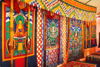 Photo of richly decorated Bhutanese Tapestry depicting religious symbols.