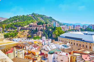 Malaga with view of the hill occupied with medieval Alcazaba fortress and topped with Gibralfaro Castle, Spain