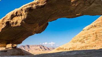 A natural rock bridge in Wadi Rum, Jordan